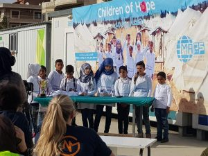 Children giving speeches in Syrian Refugee camp in Lebanon