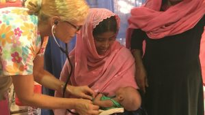 MedGlobal volunteer, Dr. Desiree, treating six-week old Rohingya patient in Bangladesh refugee camp