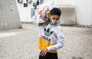 Boy in Ecuador receiving health and food basket
