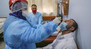 A hospital staff member gets tested for coronavirus in Rafah in the southern Gaza Strip