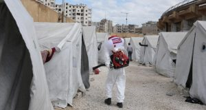 A disinfection operation at a camp for displaced people in Idlib, Syria
