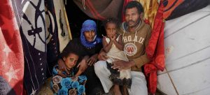UNOCHA/Giles Clarke Displaced from the city of Taiz, a family lives in a tent in Fazal, Yemen.